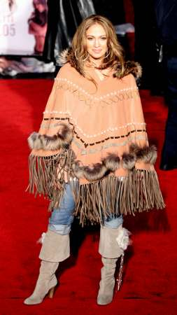 Someone tell the J-Lo that the poncho it is over.