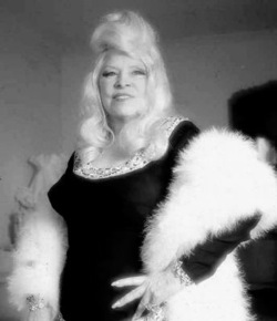 Mae West, the Madonna of her day, well past her day.