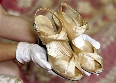 Shoes from the hand of Edward Rayne, by appointment to her Majesty Elizabeth Regina